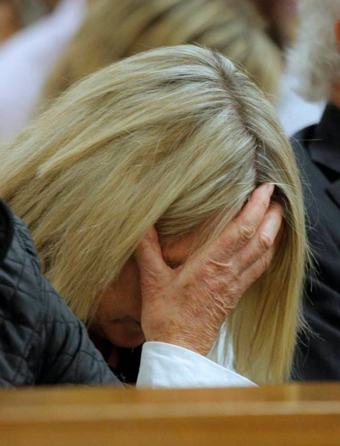 epa04158910 June Steenkamp, mother of murdered model Reeva Steenkamp reacts to the testimony of South African Paralympic athlete Oscar Pistorius during his ongoing murder trial, Pretoria, South Africa, 08 April 2014. There is no television or photographic coverage of Oscar Pistorius' testimony allowed. Pistorius stands trial for the premeditated murder of his model girlfriend Reeva Steenkamp in February 2013.  EPA/KIM LUDBROOK / POOL